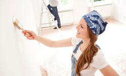 young-woman-painting-interior-walls-2