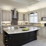 lush kitchen with black cabinets in the center