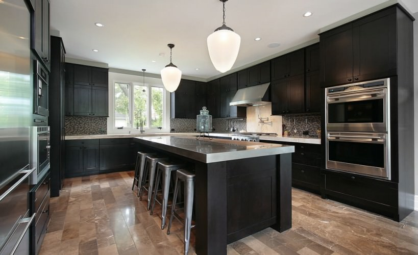 kitchen with black cabinets and funky modern twist