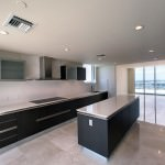 spacious kitchen with black cabinets