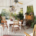British Coloinal style, coastal outdoor space with bamboo and white among lush tropical greenery.