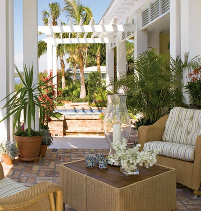 Coastal inspired patio with wicker furniture
