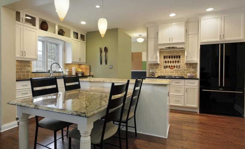 stunning open plan kitchen with granite table and adequate lighting