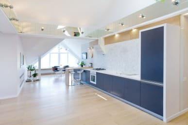 spacious open plan blue kitchen