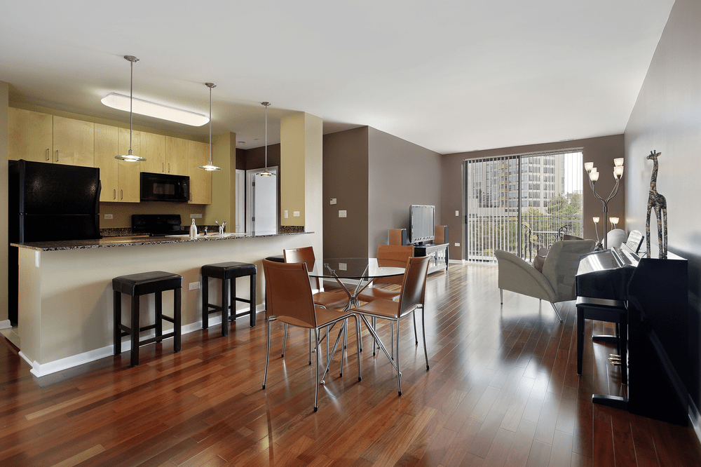 big open plan kitchen with hardwood flooring perfect for catching up
