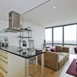 brilliant open plan kitchen leading to modern lounge