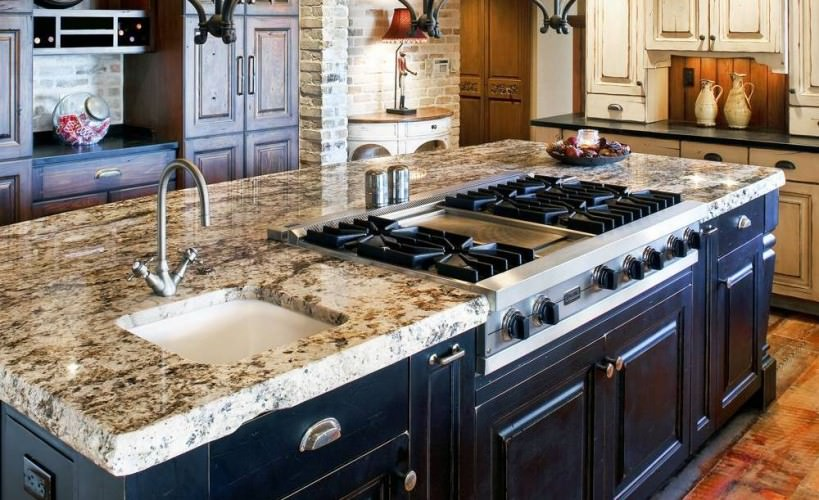 rustic kitchen with center island stove and sink