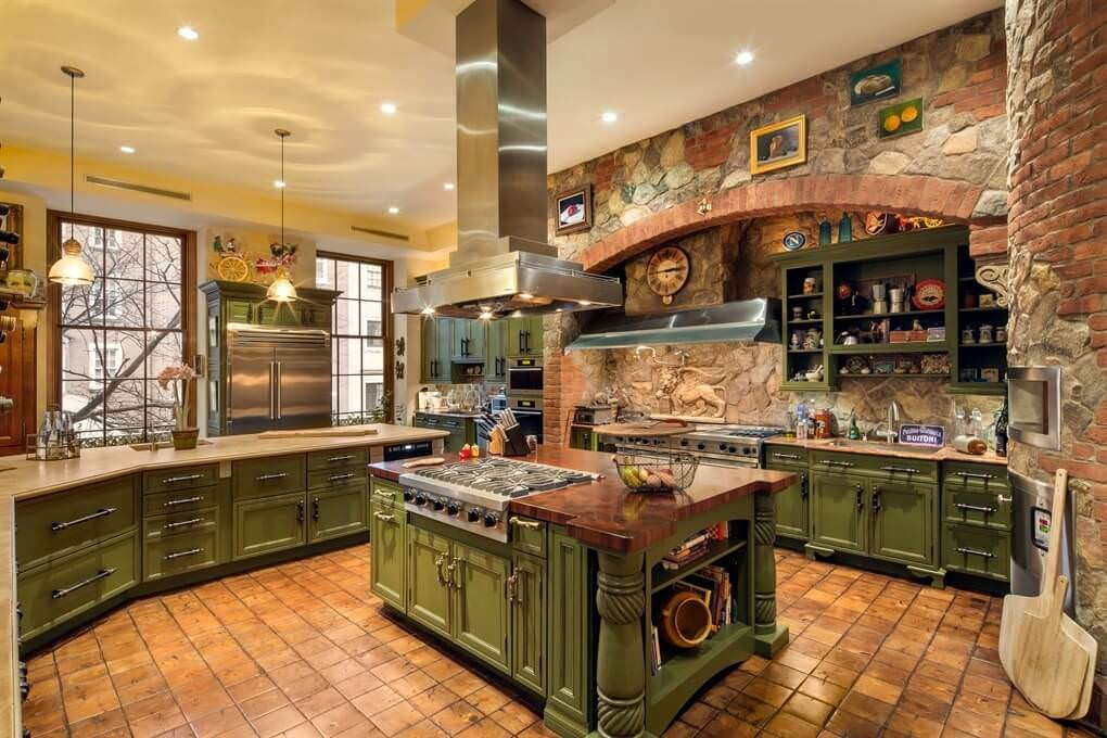 large rustic kitchen featuring a gorgeous stone wall with nice traditional brick accents and green cabinetry