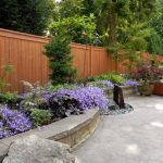 Rustic Patio with Cedar Wood Panel Privacy Fence, exterior tile floors
