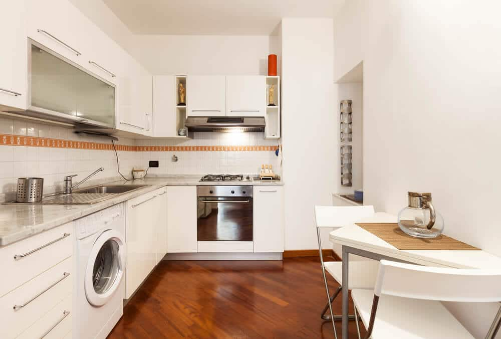 savvy small kitchen with white cabinets