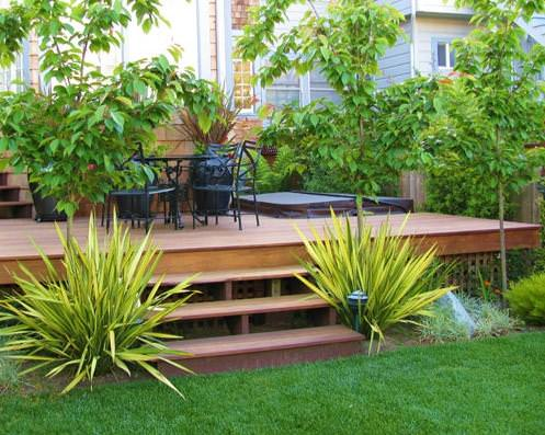 landscaping and backyard deck